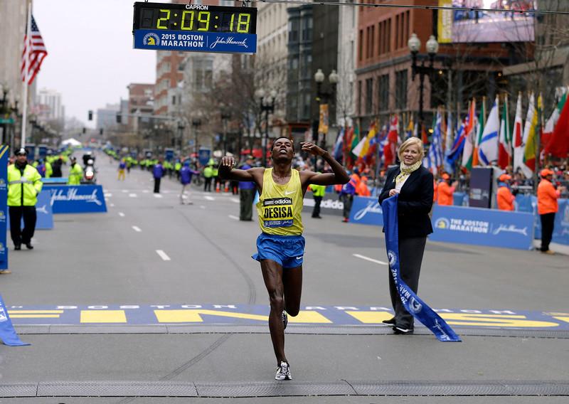 . Lelisa Desisa, of Ethiopia, crosses the finish line to win the Boston Marathon, Monday, April 20, 2015, in Boston. (AP Photo/Charles Krupa)