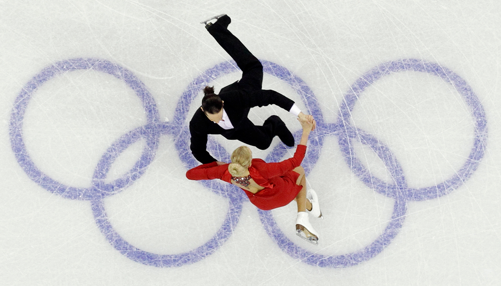 . Russia\'s Oksana Domnina and Maxim Shabalin perform their compulsory dance during the ice dance figure skating competition at the Vancouver 2010 Olympics in Vancouver, British Columbia, Friday, Feb. 19, 2010. (AP Photo/David J. Phillip)