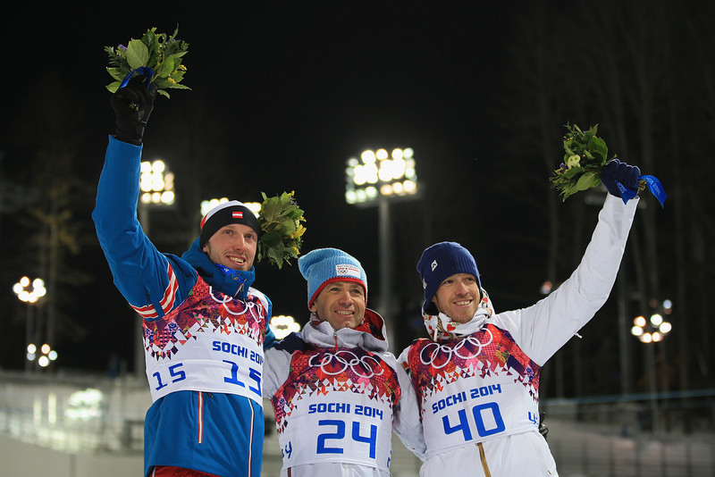 . Gold medalist Ole Einar Bjoerndalen (C) of Norway, silver medallist Dominik Landertinger of Austria (L) and bronze medallist Jaroslav Soukup of the Czech Republic competes in the Men\'s Sprint 10 km during day one of the Sochi 2014 Winter Olympics at Laura Cross-country Ski & Biathlon Center on February 8, 2014 in Sochi, Russia.  (Photo by Richard Heathcote/Getty Images)