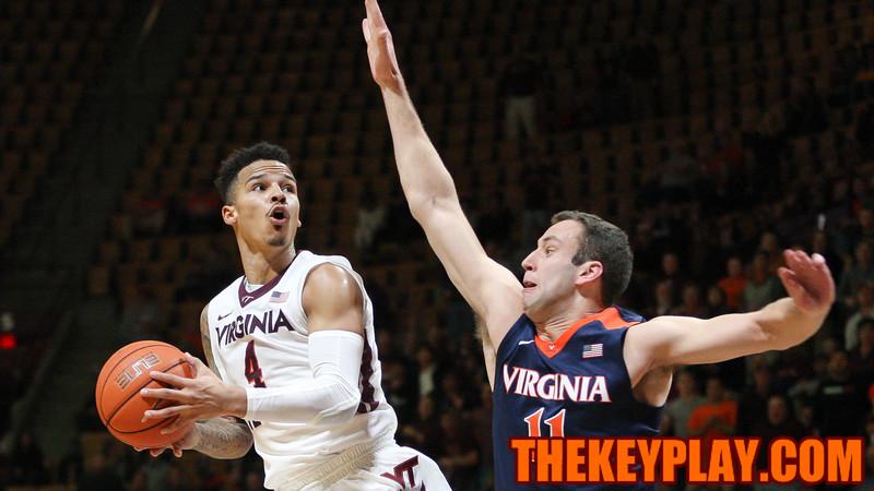 Seth Allen looks to float a shot up over UVA's Evan Nolte in the second half. (Mark Umansky/TheKeyPlay.com)