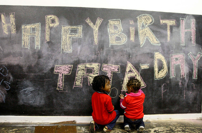 . Children from a Johannesburg creche sit before a chalk board with a message wishing former President Nelson Mandela a happy birthday  July 18, 2013.  The ailing Mandela turns 95 today.  REUTERS/Mujahid Safodien