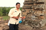 Smiling Albino Host Mr. Vuthy pouring champange for sundown at Pre Rup