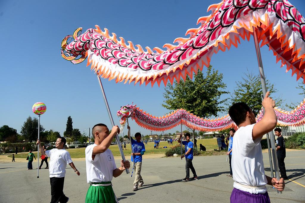 . Matt Lau, of the San Gabiel Valley Chinese Cultural Association, teaches the dragon dance during the 4th Annual San Gabriel Youth Summit at Columbia School in El Monte Saturday, March 23, 2013. (SGVN/Staff Photo by Sarah Reingewirtz)