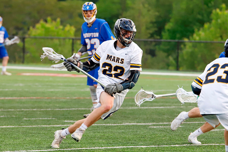 Mars' Mike Doyle pushes the ball down field in the Planet's come from behind overtime win. Seb Foltz/Butler Eagle