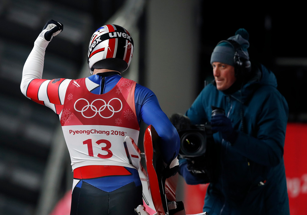 . Chris Mazdzer of United States pumps his fist in the finish area after the third run during final heats of the men\'s luge competition at the 2018 Winter Olympics in Pyeongchang, South Korea, Sunday, Feb. 11, 2018. (AP Photo/Andy Wong)