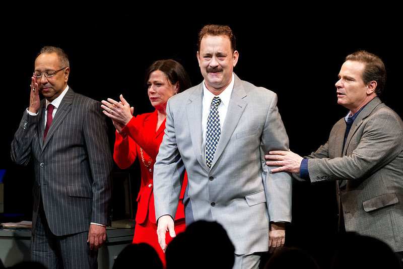 ". This April 1, 2013 file photo shows, from left, George C. Wolfe, Maura Tierney, Tom Hanks and Peter Scolari at the Lucky Guy Opening Night, in New York. Hanks received a Tony nomination for best leading actor in a play, Tuesday, April 30, for his role in ""Lucky Guy.\"" The awards will be broadcast on CBS from Radio City Music Hall on June 9.  (Photo by Dario Cantatore/Invision/AP, file)"