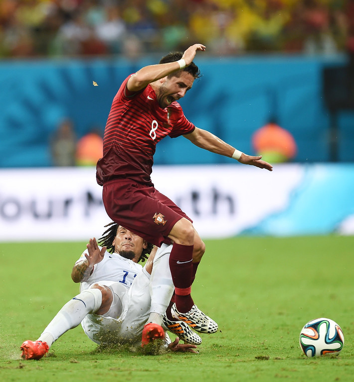 . United States\' Jermaine Jones, bottom. fouls Portugal\'s Joao Moutinho during the group G World Cup soccer match between the USA and Portugal at the Arena da Amazonia in Manaus, Brazil, Sunday, June 22, 2014. (AP Photo/Paulo Duarte)