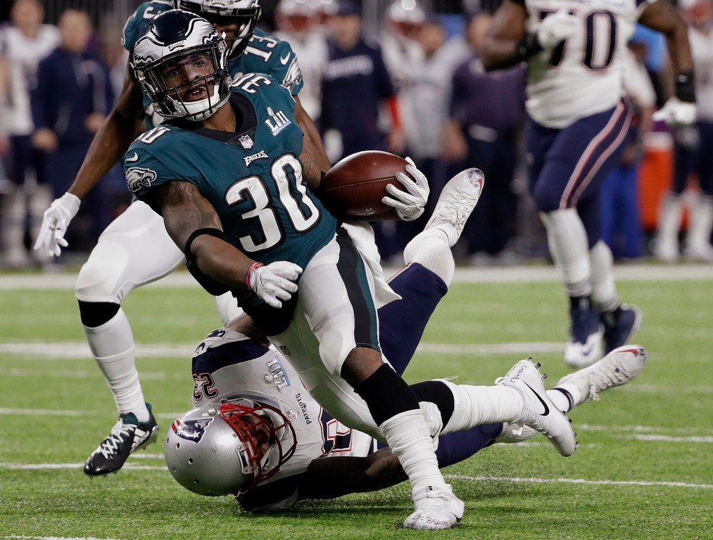 . Philadelphia Eagles running back Corey Clement (30) is tackled by New England Patriots strong safety Patrick Chung (23), during the first half of the NFL Super Bowl 52 football game, Sunday, Feb. 4, 2018, in Minneapolis. (AP Photo/Chris O\'Meara)