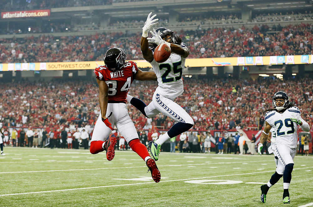 . Richard Sherman #25 of the Seattle Seahawks breaks up a pass intended for  Roddy White #84 of the Atlanta Falcons during the NFC Divisional Playoff Game at Georgia Dome on January 13, 2013 in Atlanta, Georgia.  (Photo by Kevin C. Cox/Getty Images)