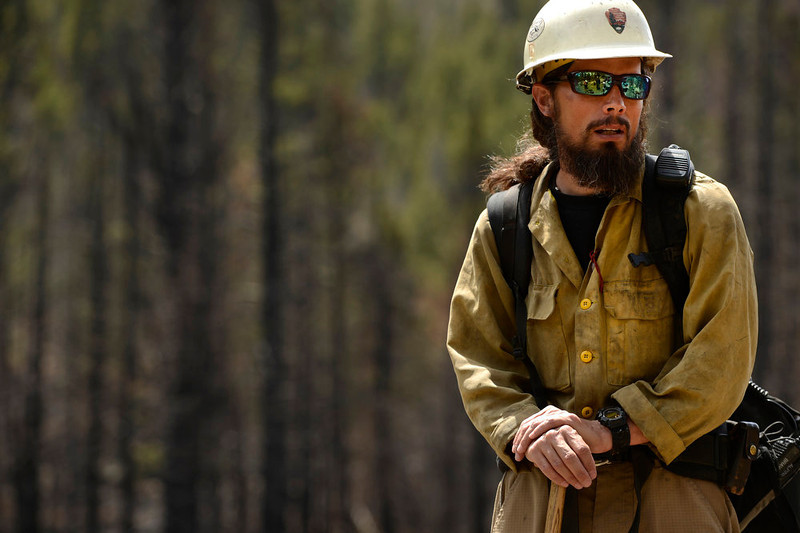 . Mark Mendonca, a Captain with the Alpine Hotshots, shows some of the Fern Lake fire burned areas along the Cub Lake trail in Rocky Mountain National Park on May 13, 2013. He and members of his Hotshot crew worked the Fern Fire in November and December.   (Photo by Helen H. Richardson/The Denver Post)