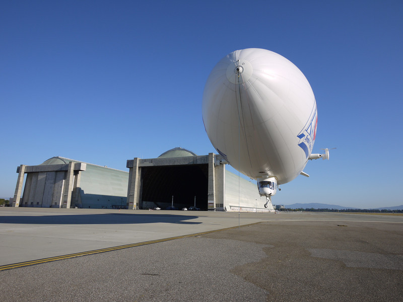 The Airship Ventures Zeppelin coming down for a landing near Hangars 2 and 3 at NASA's historic Moffett Field in Mountain View, California.