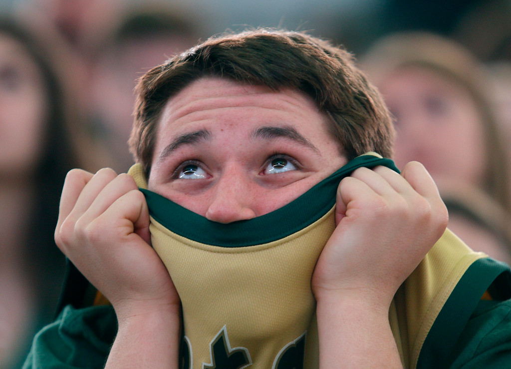 . Michigan State fan Nick Scott watches the closing minutes of the broadcast of a Final Four semifinal in the NCAA men\'s college basketball tournament between Michigan State and Duke, Saturday, April 4, 2015, at the Breslin Center in East Lansing, Mich. Duke defeated Michigan State 81-61 in Indianapolis. (AP Photo/Al Goldis)