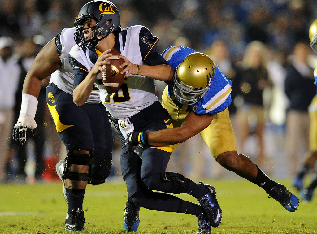 . UCLA linebacker Anthony Barr sacks California quarterback Jared Goff (16) during the first half of their college football game in the Rose Bowl in Pasadena, Calif., on Saturday, Oct. 12, 2013.  (Keith Birmingham Pasadena Star-News)