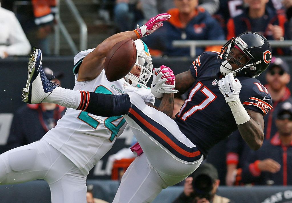 . Cortland Finnegan #24 of the Miami Dolphins breaks up a pass intended for  Alshon Jeffery #17 of the Chicago Bears at Soldier Field on October 19, 2014 in Chicago, Illinois.  (Photo by Jonathan Daniel/Getty Images)