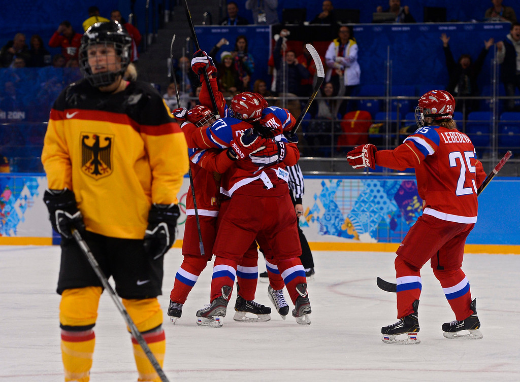 . Olga Sosina of Russia celebrates with teammates after scoring a goal against Germany in the third period during their match in the Ice Hockey tournament at the Sochi 2014 Olympic Games in Sochi, Russia, 09 February 2014.  EPA/LARRY W. SMITH