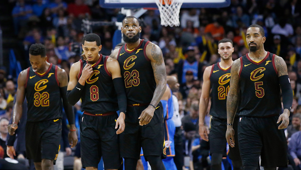 . Cleveland Cavaliers forward Jeff Green (32), guard Jordan Clarkson (8), forward LeBron James (23), forward Larry Nance Jr. (24) and J.R. Smith (5) walk off the court during a time out in the second half of an NBA basketball game against the Oklahoma City Thunder in Oklahoma City, Tuesday, Feb. 13, 2018. (AP Photo/Sue Ogrocki)
