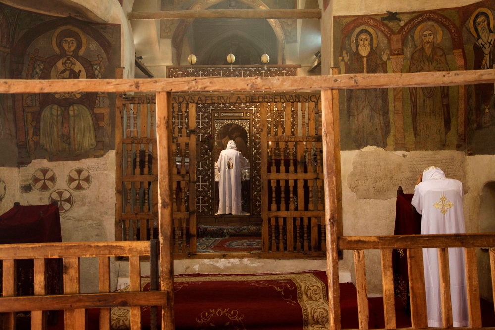 . Monks pray in a chapel on Tuesday, April 16, 2013 dating back to the fourth century at the ancient monastery of St. Anthony, in the eastern desert southeast of Cairo, Egypt. In a cave high in the desert mountains of eastern Egypt, the man said to be the father of monasticism took refuge from the temptations of the world some 17 centuries ago. The monks at the St. Anthony\'s Monastery bearing his name continue the ascetic tradition. But even they are not untouched by the turbulent times facing Egypt\'s Christians, defiantly vowing their community\'s voice won\'t be silenced amid Islamists\' rising power. (AP Photo/Manoocher Deghati)