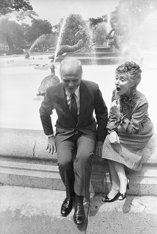 . Ohio Sen. John H. Glenn Jr., and his wife, Annie, start to jump away as they are caught in a cloud of windblown spray during a pause in a walking tour in the Logan Circle area of Philadelphia on June 25, 1982. The Glenns are attending the Democratic National Party Conference which runs through Sunday at the Civic Center. (AP Photo/Bill Ingraham)