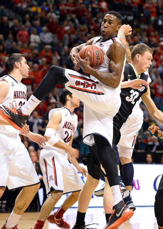 . LAS VEGAS, NV - MARCH 14:  Rondae Hollis-Jefferson #23 of the Arizona Wildcats grabs a rebound against Ben Mills #32 of the Colorado Buffaloes during a semifinal game of the Pac-12 Basketball Tournament at the MGM Grand Garden Arena on March 14, 2014 in Las Vegas, Nevada. Arizona won 63-43.  (Photo by Ethan Miller/Getty Images)