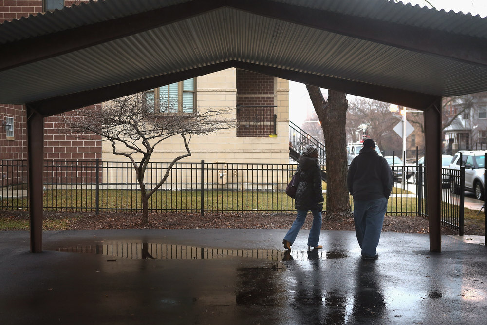 . Nate Pendleton (R) walks under the shelter at a neighborhood park where his daughter Hadiya was killed on January 30, 2013 in Chicago, Illinois. Fifteen-year-old Hadiya was shot and killed when a gunman opened fire in the park yesterday while she was hanging out with friends on the warm rainy afternoon under a shelter in the park. Hadiya was a majorette in her high school band and recently performed in Washington, D.C. during the inauguration. President Obama\'s Chicago home is less than a mile from the park where Hadiya was killed.   Another person was wounded in the leg during the shooting.   (Photo by Scott Olson/Getty Images)