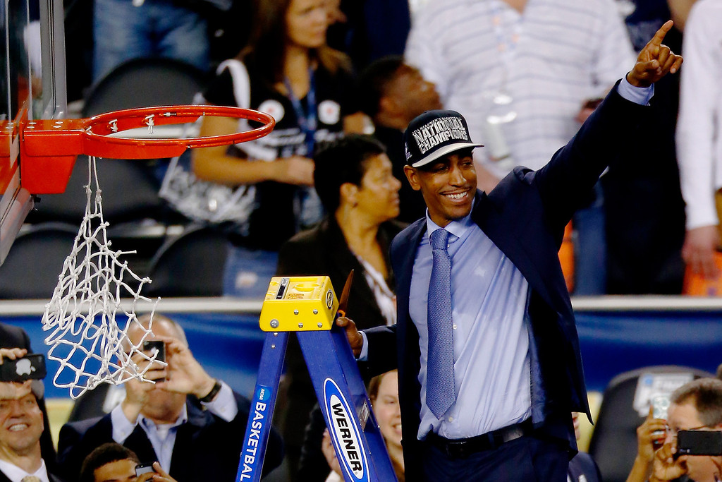 . ARLINGTON, TX - APRIL 07:  Head coach Kevin Ollie of the Connecticut Huskies acknowledges the crowd after defeating the Kentucky Wildcats 60-54 in the NCAA Men\'s Final Four Championship at AT&T Stadium on April 7, 2014 in Arlington, Texas.  (Photo by Tom Pennington/Getty Images)