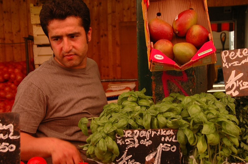 Man Selling Greens at Naschmarkt - Vienna, Austria
