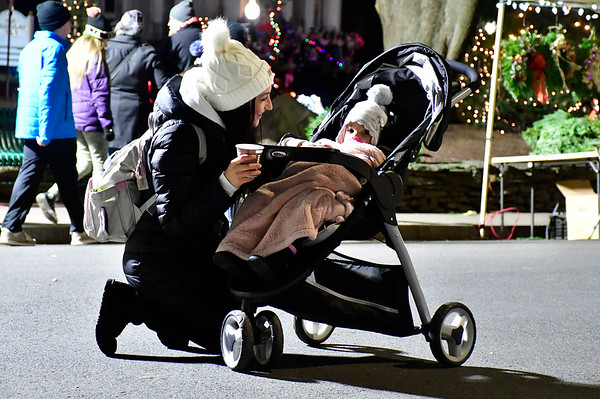 12/7/2018 Mike Orazzi | Staff Sana Milo and her daughter Liana 1 1/2 during White Christmas in the Community in downtown Southington Friday evening.