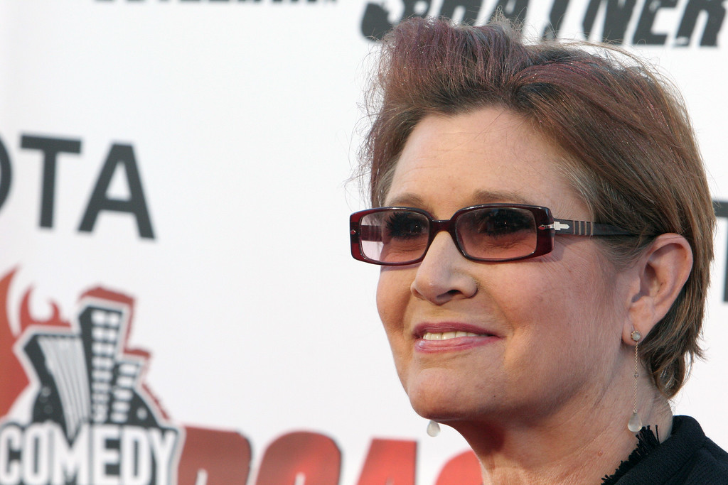 """. Actress Carrie Fisher poses for photographers on the red carpet before Comedy Central\'s \""""Roast of William Shatner,\"""" Sunday, Aug. 13, 2006, in Los Angeles. (AP Photo/Rene Macura)"""