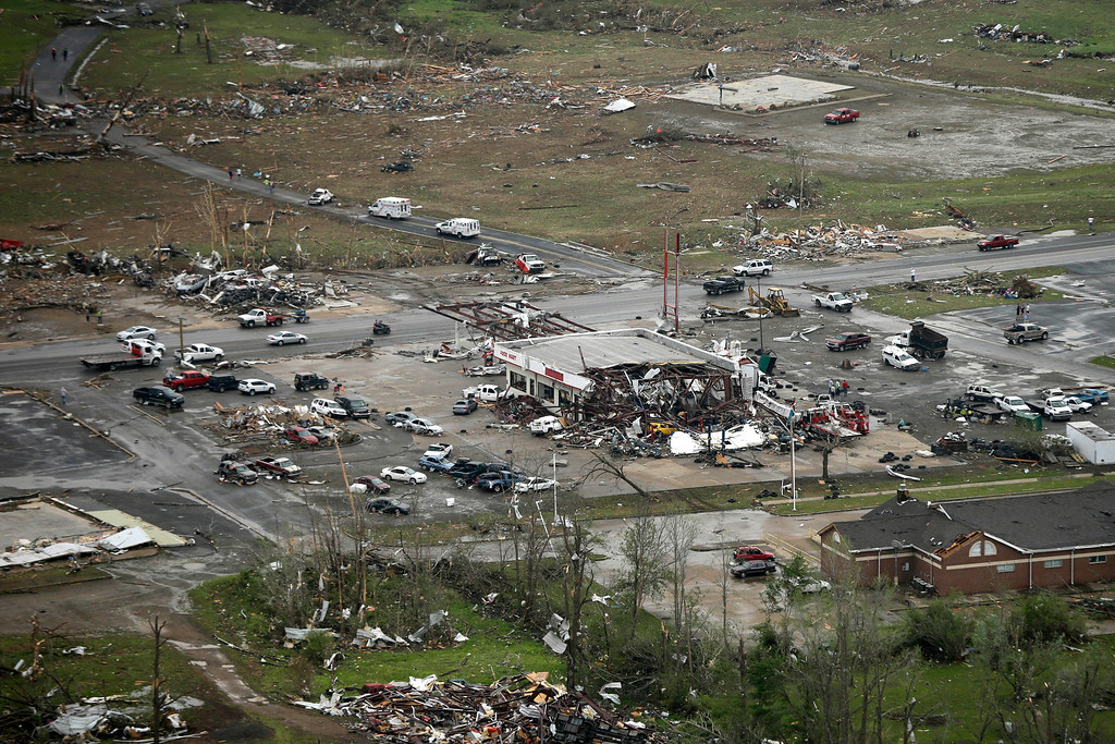 . A storm-damaged convenience store, center, sits among rubble along U.S. Highway 64 in Vilonia, Ark., Monday, April 28, 2014, after a tornado struck the town late Sunday. (AP Photo/Danny Johnston)