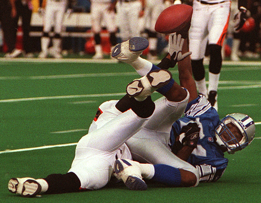 . Detroit Lions wide receiver Larry Foster (right) shows he can hold onto the ball after being taken down by Cincinnati Bengal cornerback Ligarius Jennings during the Lions 31-27 loss at the Silverdome Sunday.