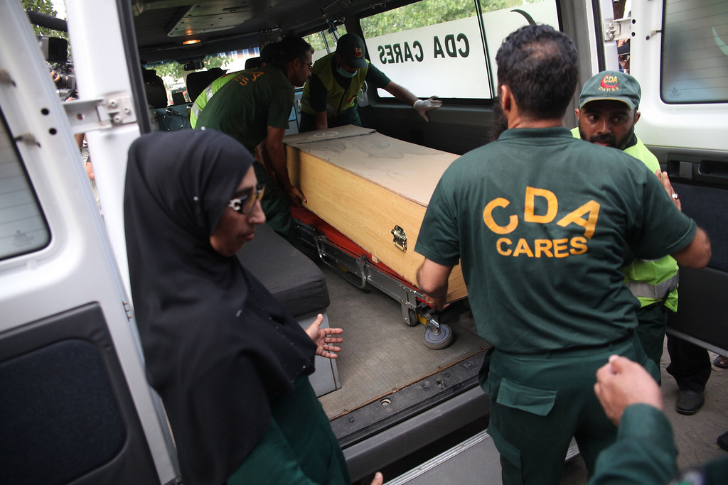 . Pakistani rescuers shift a coffin of a foreign tourist from an ambulance to a hospital in Islamabad on June 23, 2013.   FAROOQ NAEEM/AFP/Getty Images