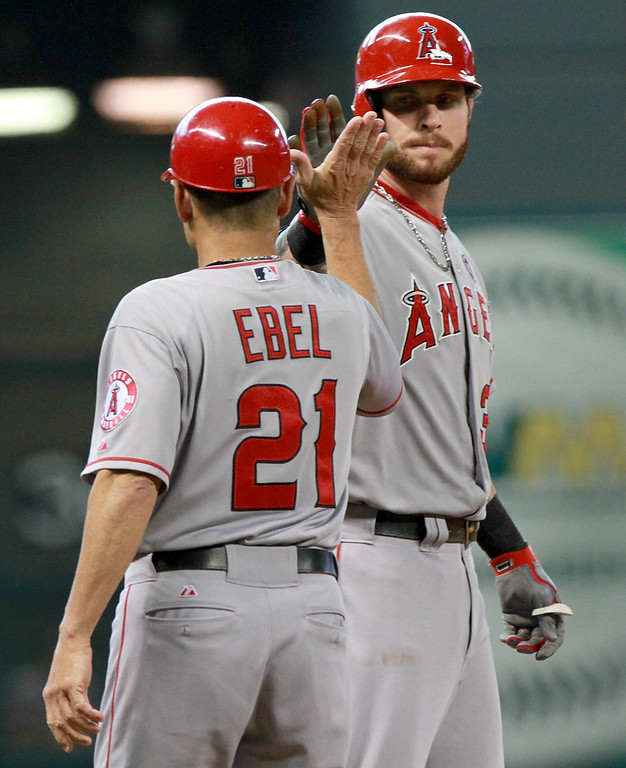 . HOUSTON, TX- SEPTEMBER 15: Josh Hamilton #32 big fives Dino Ebel #21 of the Los Angeles Angels of Anaheim after hitting a triple RBI scoring Mike Trout #27 of the Los Angeles Angels against the Houston Astros in the first inning on September 15, 2013 at Minute Maid Park in Houston, Texas. (Photo by Thomas B. Shea/Getty Images)
