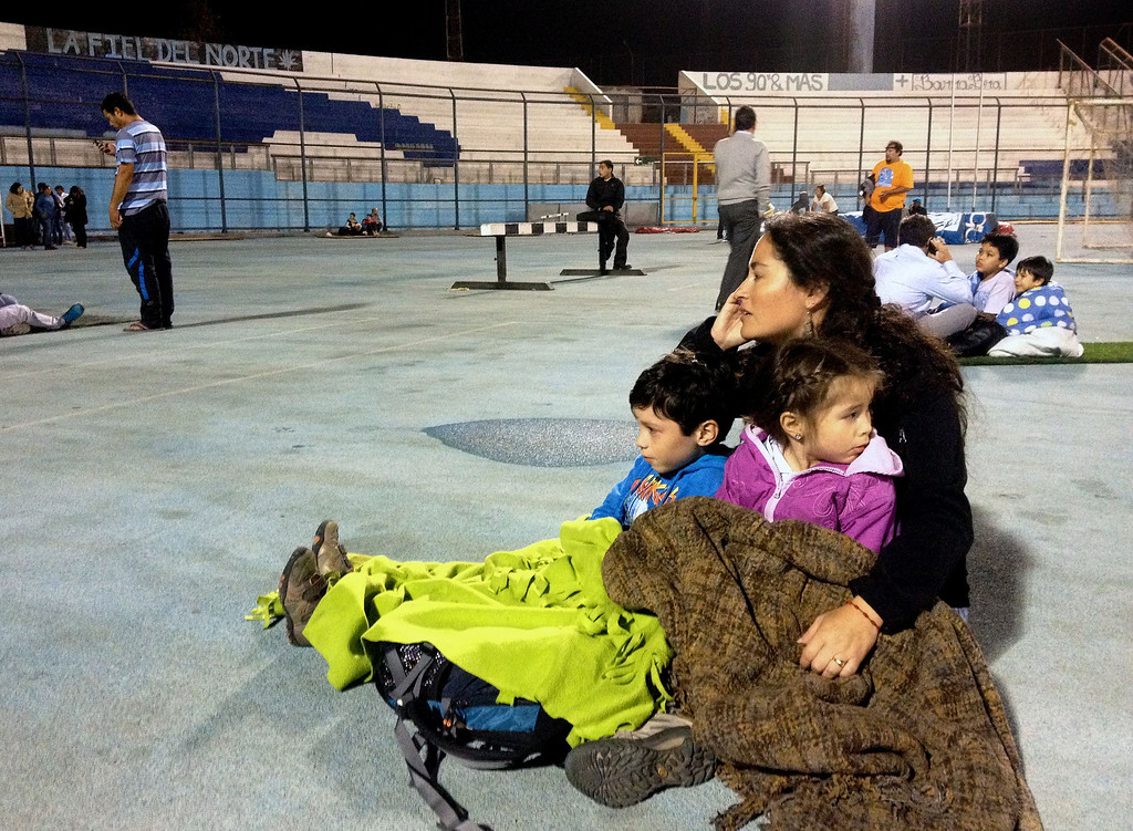 . Locals take refuge at the city stadium following a tsunami alert after a powerful 8.0-magnitude earthquake hit off Chile\'s Pacific coast, on April 1, 2014 in Iquique. A tsunami warning has been issued for Chile, Peru and Ecuador, US officials said. The quake struck at a depth of 10 kilometers (six miles), 83 kilometers from Iquique on Chile\'s northern coast, the United States Geological Survey (USGS) said.     Aldo Solimano/AFP/Getty Images