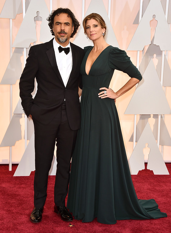 . Alejandro Gonzalez Inarritu, left, and Maria Eladia Hagerman arrives at the Oscars on Sunday, Feb. 22, 2015, at the Dolby Theatre in Los Angeles. (Photo by Jordan Strauss/Invision/AP)
