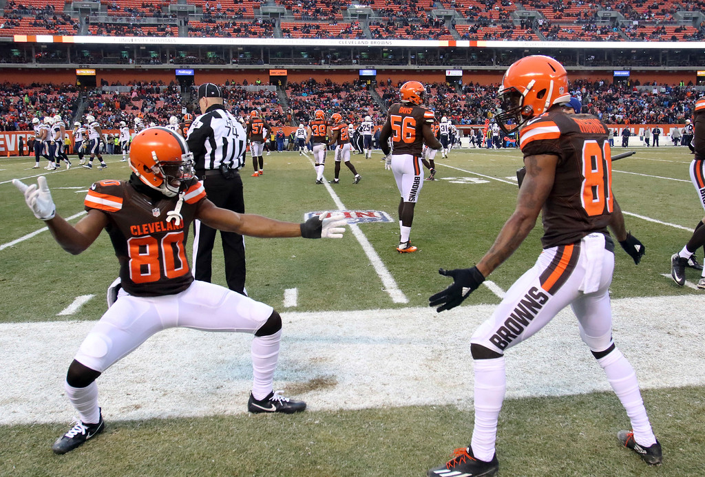 . Cleveland Browns wide receiver Ricardo Louis (80) and wide receiver Rashard Higgins (81) celebrate after making a tackle on a punt in the second half of an NFL football game against the San Diego Chargers, Saturday, Dec. 24, 2016, in Cleveland. (AP Photo/Aaron Josefczyk)