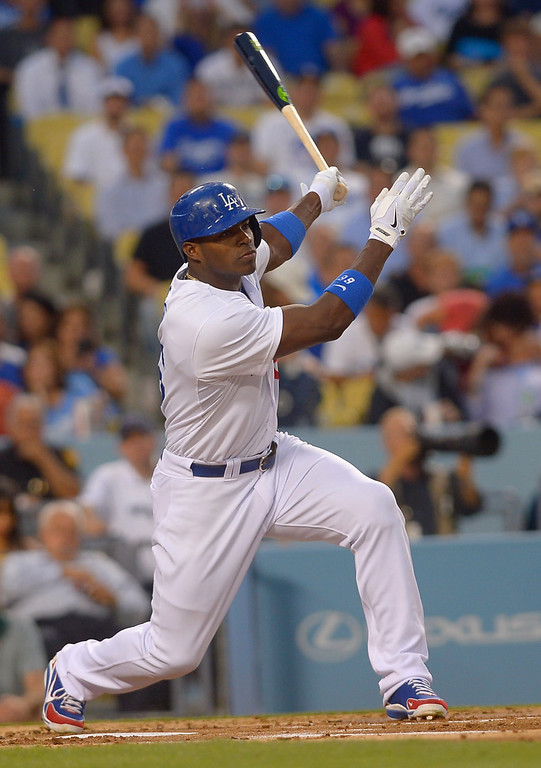 . Los Angeles Dodgers Yasiel Puig hits a double during the 1st inning against the Chicago Cubs August 26, 2013 in Los Angeles, CA.(Andy Holzman/Los Angeles Daily News)