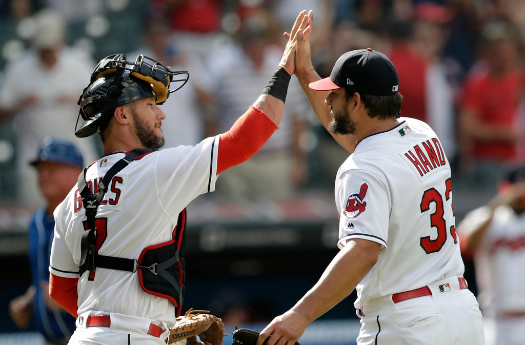 . Cleveland Indians catcher Yan Gomes, left, celebrates with relief pitcher Brad Hand after the Indians defeated the Kansas City Royals 3-1 in a baseball game, Wednesday, Sept. 5, 2018, in Cleveland. (AP Photo/Tony Dejak)