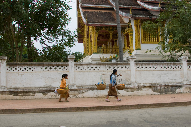 Women peddling goods outside the temple in Luang Prabang, Laos