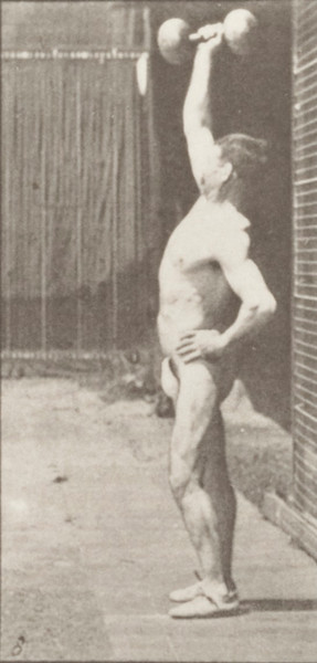 Man in pelvis cloth lifting weight