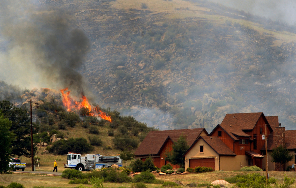 . Poudre Fire Authority had hand crews and structural engines around this house to protect it from the approaching fire. The High Park fire northwest of Fort Collins continues to burn today June 10th, 2012.  The fire is now estimated at over 14,000 acres and still zero percent containment. Helen H. Richardson, The Denver Post