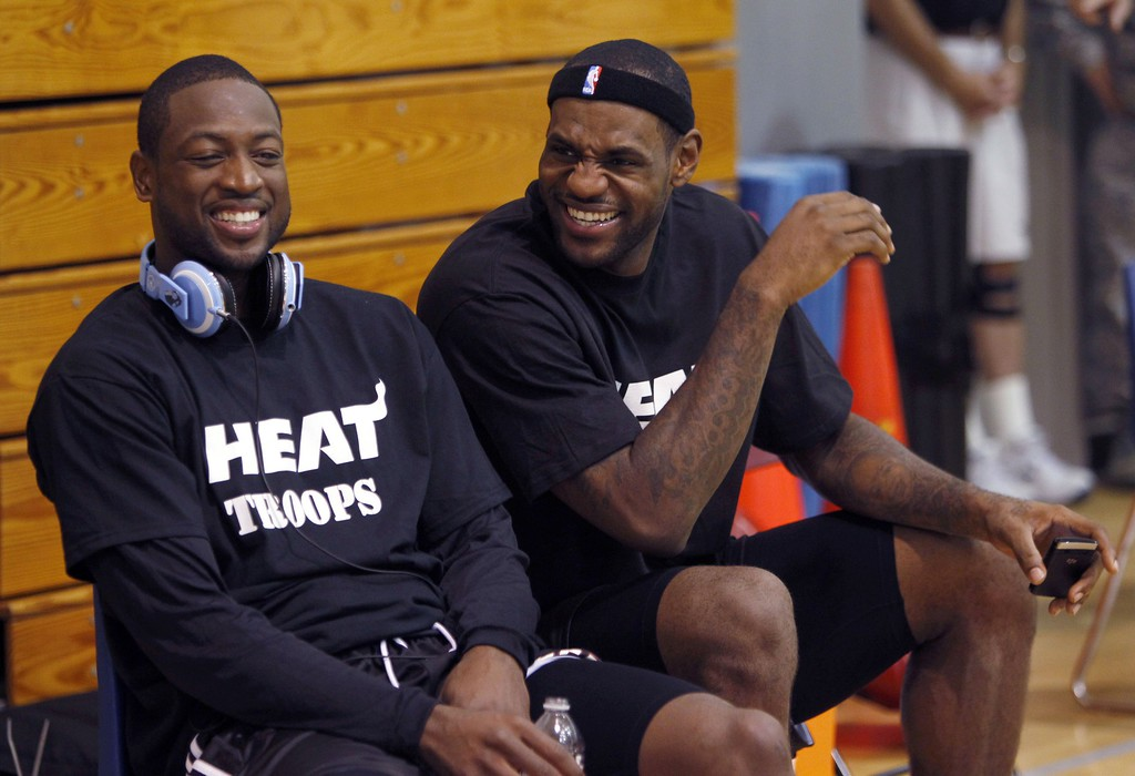 . Miami Heat players Dwyane Wade, left, and LeBron James share a laugh after NBA training camp at Hurlburt Field Wednesday, Sept. 29, 2010 in Hurlburt Field, Fla. (AP Photo/Wilfredo Lee)