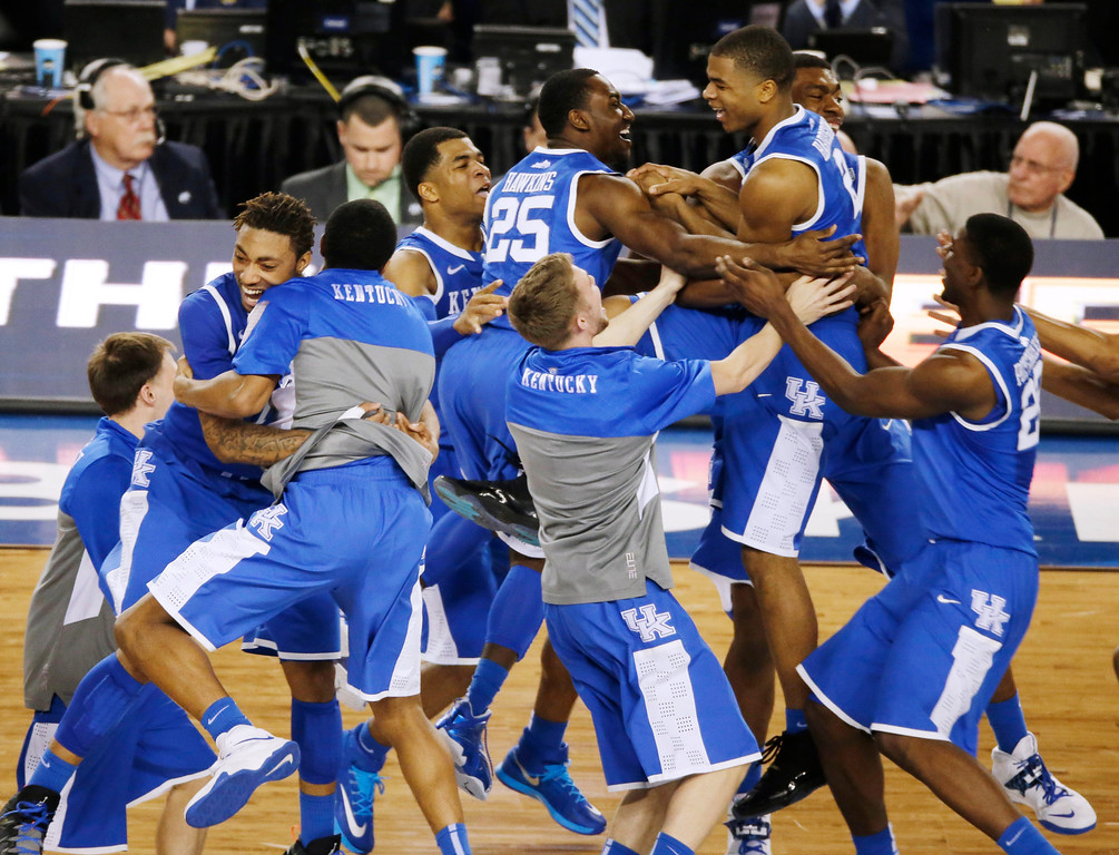 . Kentucky celebrates after guard Aaron Harrison made a three-point basket in the final seconds against Wisconsin to win the game 74-73 during their NCAA Final Four tournament college basketball semifinal game Saturday, April 5, 2014, in Arlington, Texas. (AP Photo/Tony Gutierrez)