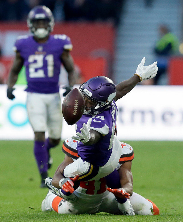 . Minnesota Vikings wide receiver Stefon Diggs (14) tries to catch the ball during the second half of an NFL football game against Cleveland Browns at Twickenham Stadium in London, Sunday Oct. 29, 2017. (AP Photo/Tim Ireland)