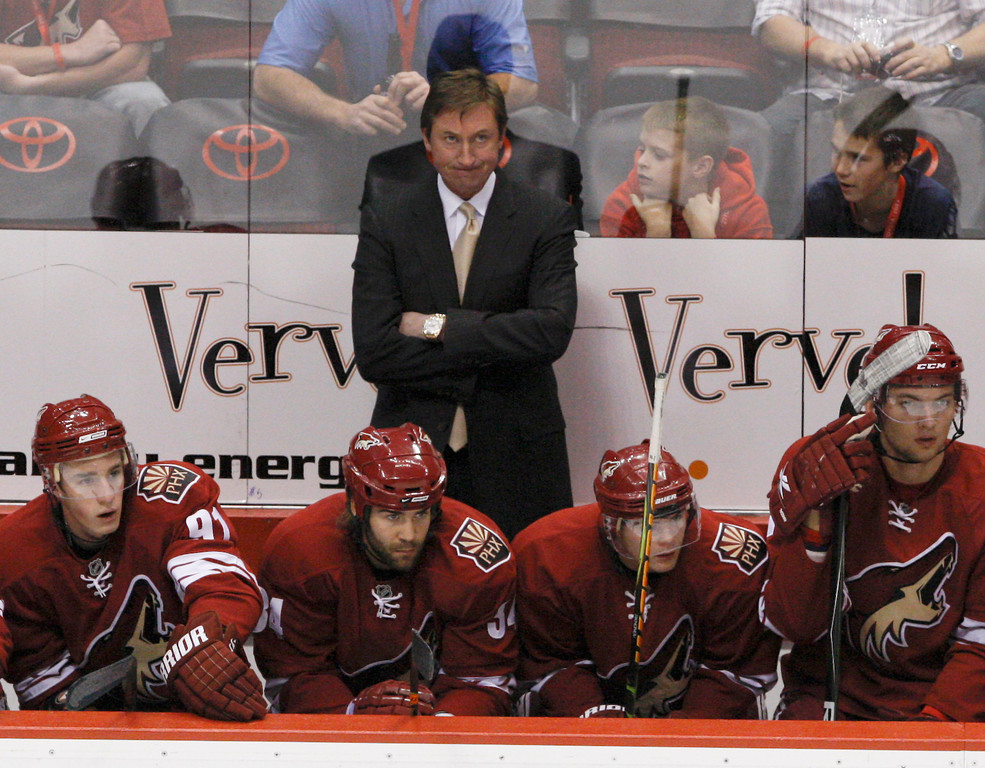. Phoenix Coyotes head coach Wayne Gretzky watches the scoreboard as his team falls behind against the Calgary Flames in the first period during an NHL Hockey game in Glendale, Ariz. Saturday Oct. 25, 2008. (AP Photo/Aaron J. Latham)