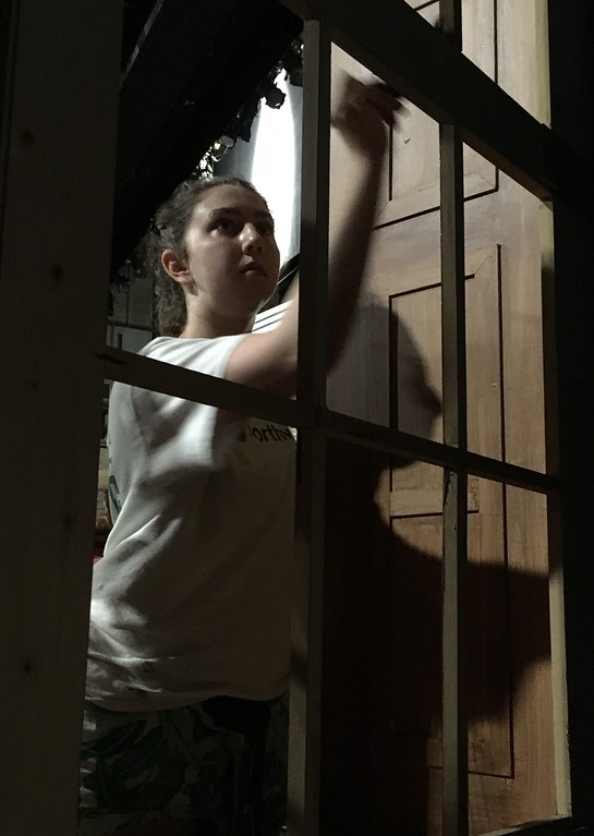 ". Richard Payerchin � The Morning Journal <br> Oberlin College theater student Abigail Bowman paints a window in the set of ""Little Women,\"" one of three free plays that will be part of the 2018 Oberlin Summer Theater Festival. A native of New York city, Bowman will be a junior in the upcoming school year."