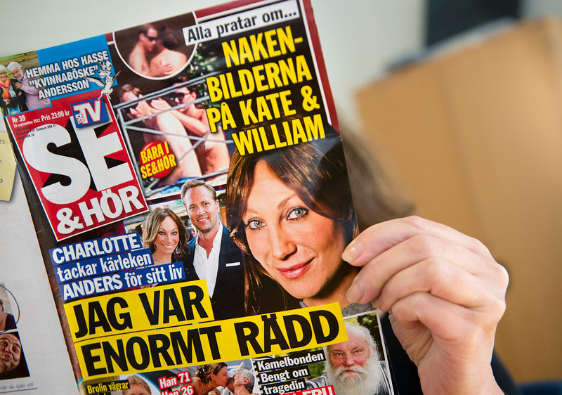 ". A woman holds a copy of the Swedish celebrity magazine Se & Hor in Stockholm on September 20, 2012,  showing Britain\'s Prince William and a topless Catherine Duchess of Cambridge while on holiday in France on September 5.  Swedish celebrity magazine yesterday published pictures of Prince William\'s wife Catherine sunbathing topless, a day before a Danish publication was to do the same despite fury from the British royals. The publication in Sweden did not make headlines, with only two tabloids mentioning it and the rest of the media ignoring it.  ""Kate Middleton Pictures Released\"" ranked as Google\'s second most searched trending event of 2012. \""Kate Middleton\"" ranked sixth in searches overall. JONATHAN NACKSTRAND/AFP/GettyImages"