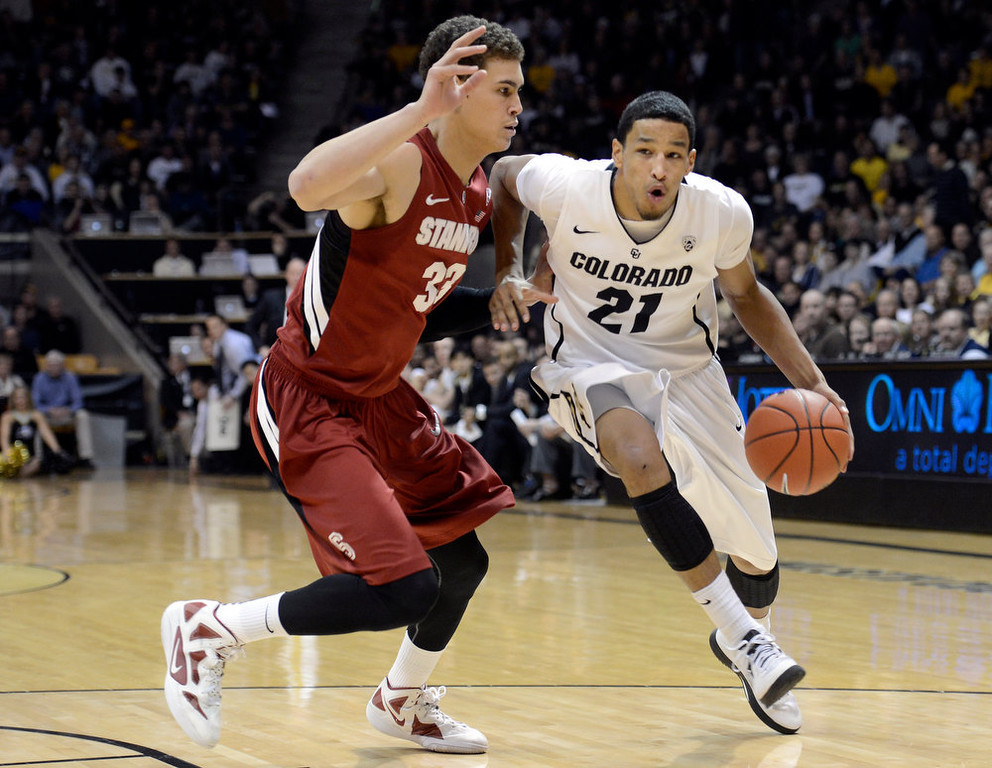 . University of Colorado\'s Andre Roberson dribbles past Dwight Powell during a game against Stanford on Thursday, Jan. 24, at the Coors Event Center on the CU campus in Boulder. Jeremy Papasso/ Camera
