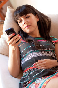 Young happy woman using her smartphone