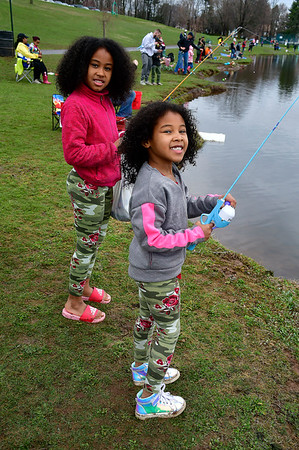 4//13/2019 Mike Orazzi | Staff Sisters Gerangelys and Berenice Canales, 8 and 6, during the city of New Britain's annual fishing derby held at Stanley Quarter Park on Saturday.