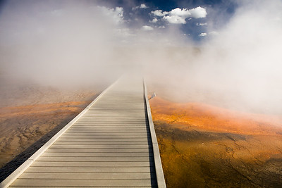 Steam engulfs the boardwalk at Grand Prismatic Spring at Midway Geyser Basin
